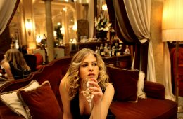 Woman drinking champagne in luxury hotel