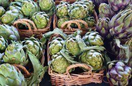 Vegan travel purple artichokes in Italian market