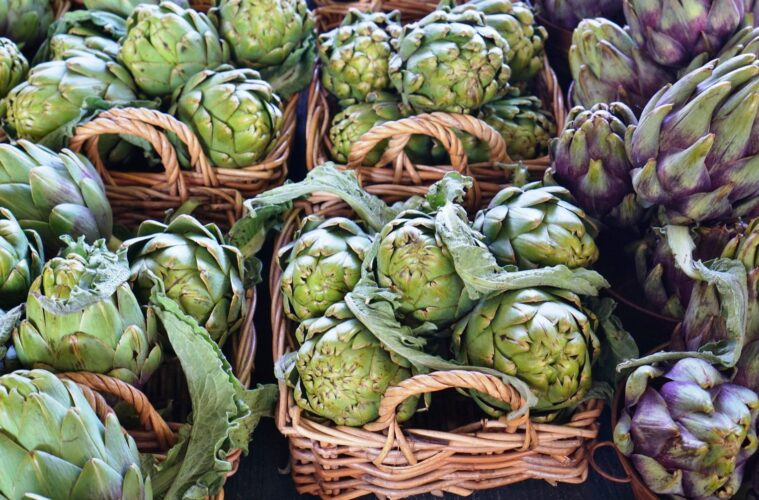 Vegan travel purple artichokes in Italian market