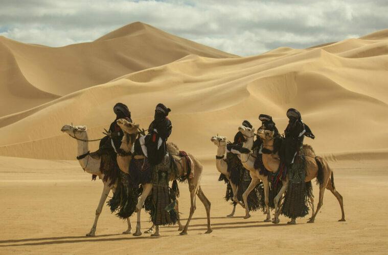 Men riding camels
