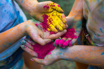 Children's hands covered in powder paint