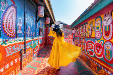 Woman standing at Rainbow village in Taichung, Taiwan