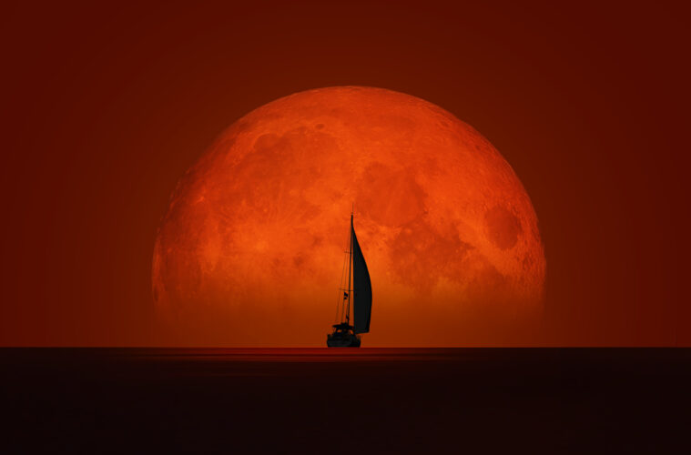 Yacht against a red moon