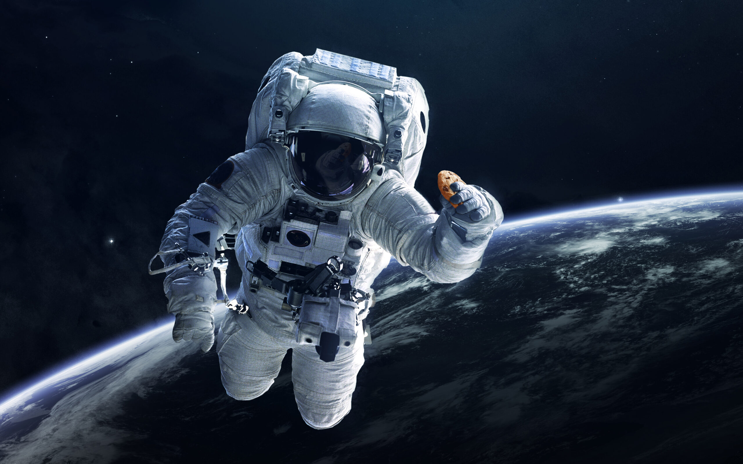 Astronaut holding Doubletree cookie