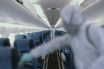 HazMat team decontaminating airplane cabin during virus outbreak