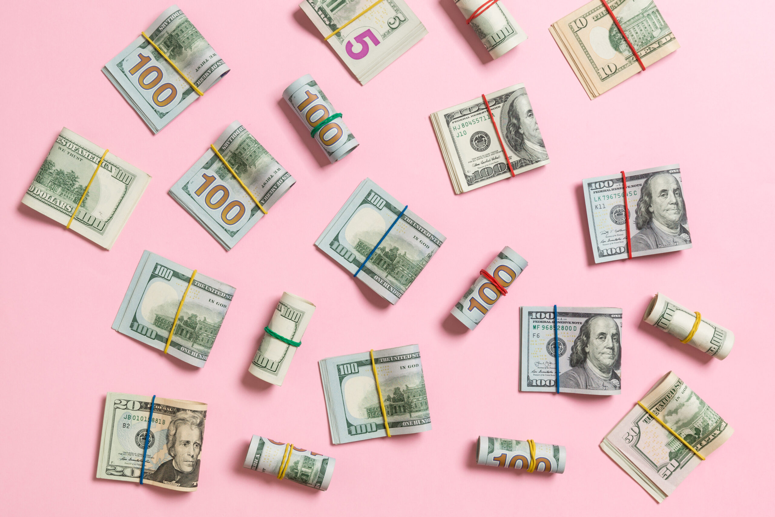 US dollars on a pink background