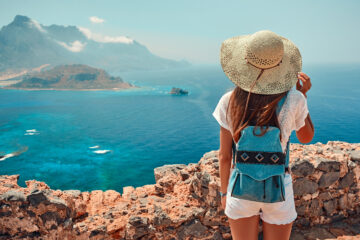 Girl with backpack, tourism by sea