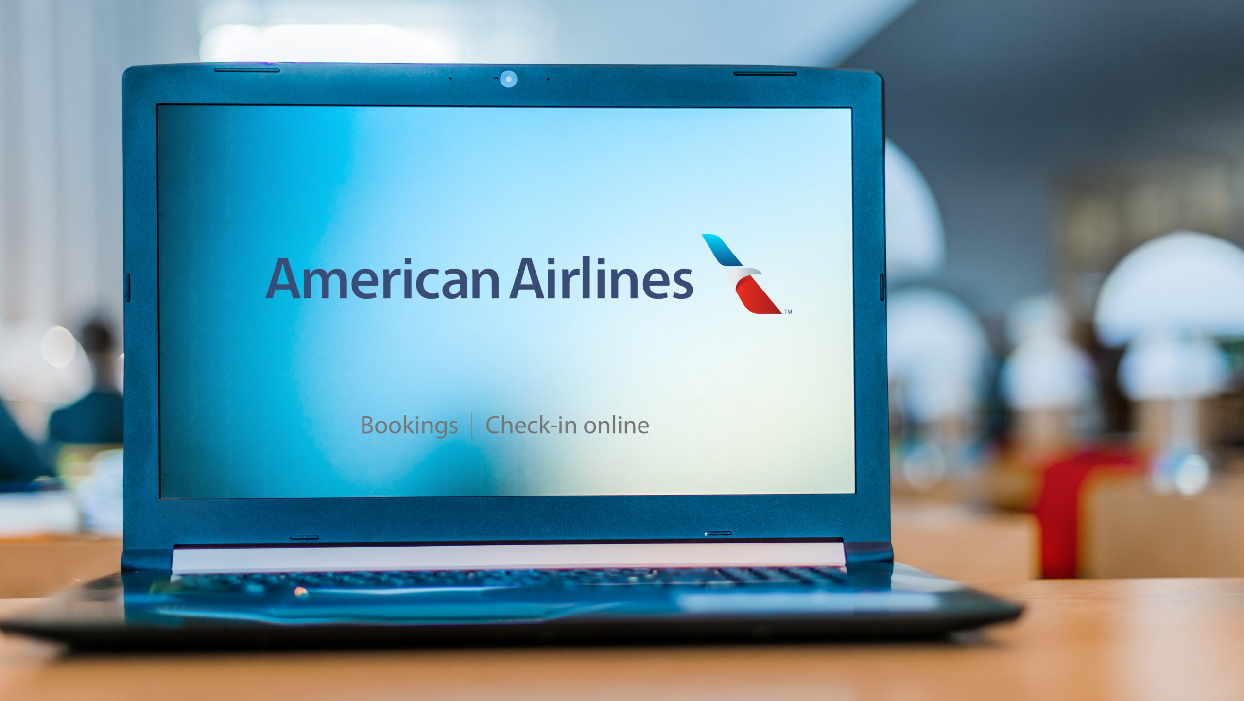 Laptop computer displaying logo of American Airlines