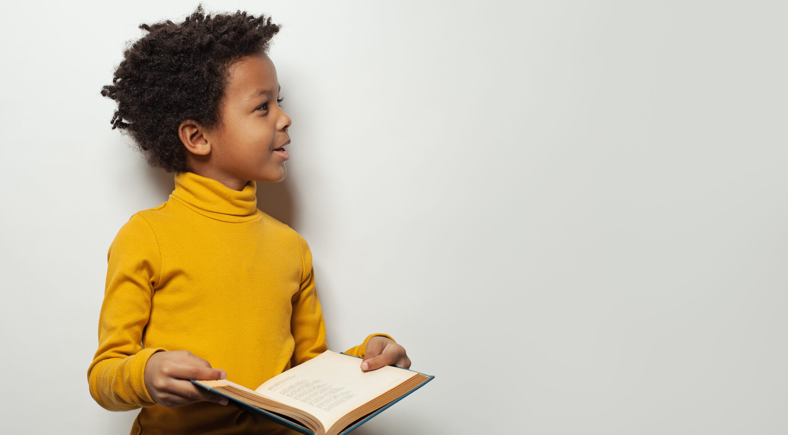 Child holding a book