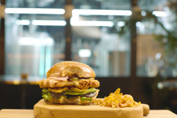 SuperMeat's chicken burger, pilot plant in the back