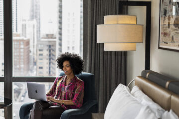 Woman Working from Hyatt hotel