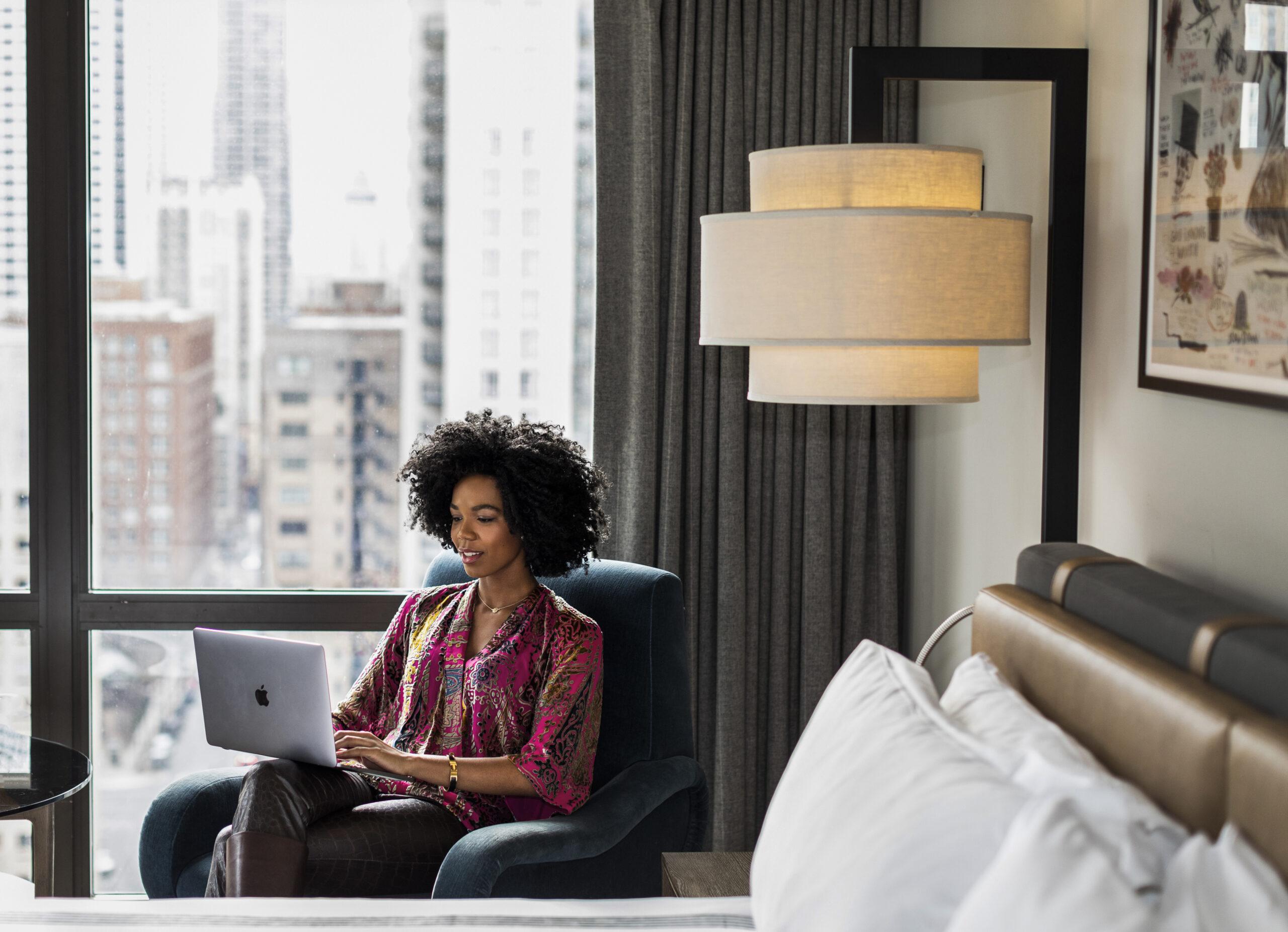 Woman Working from Hyatt hotel