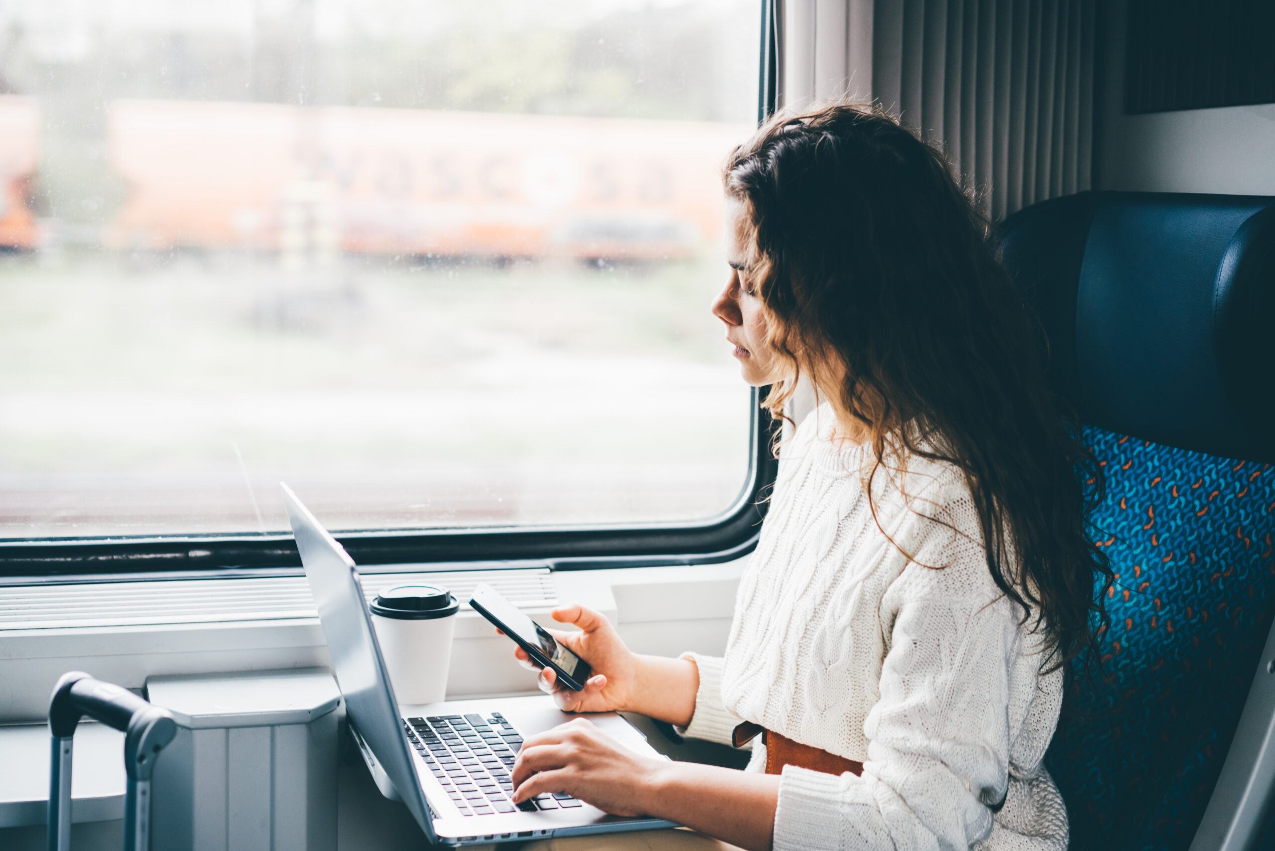 business traveller working on a train
