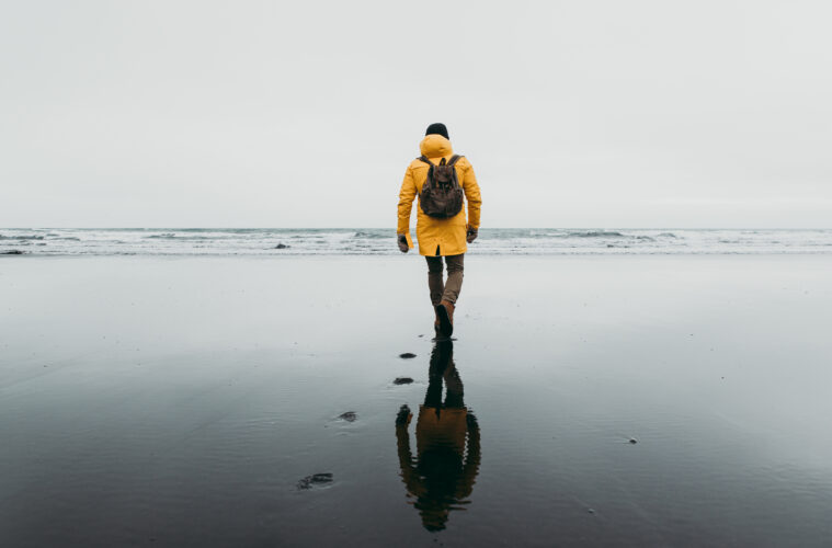 Walking along beach in Iceland