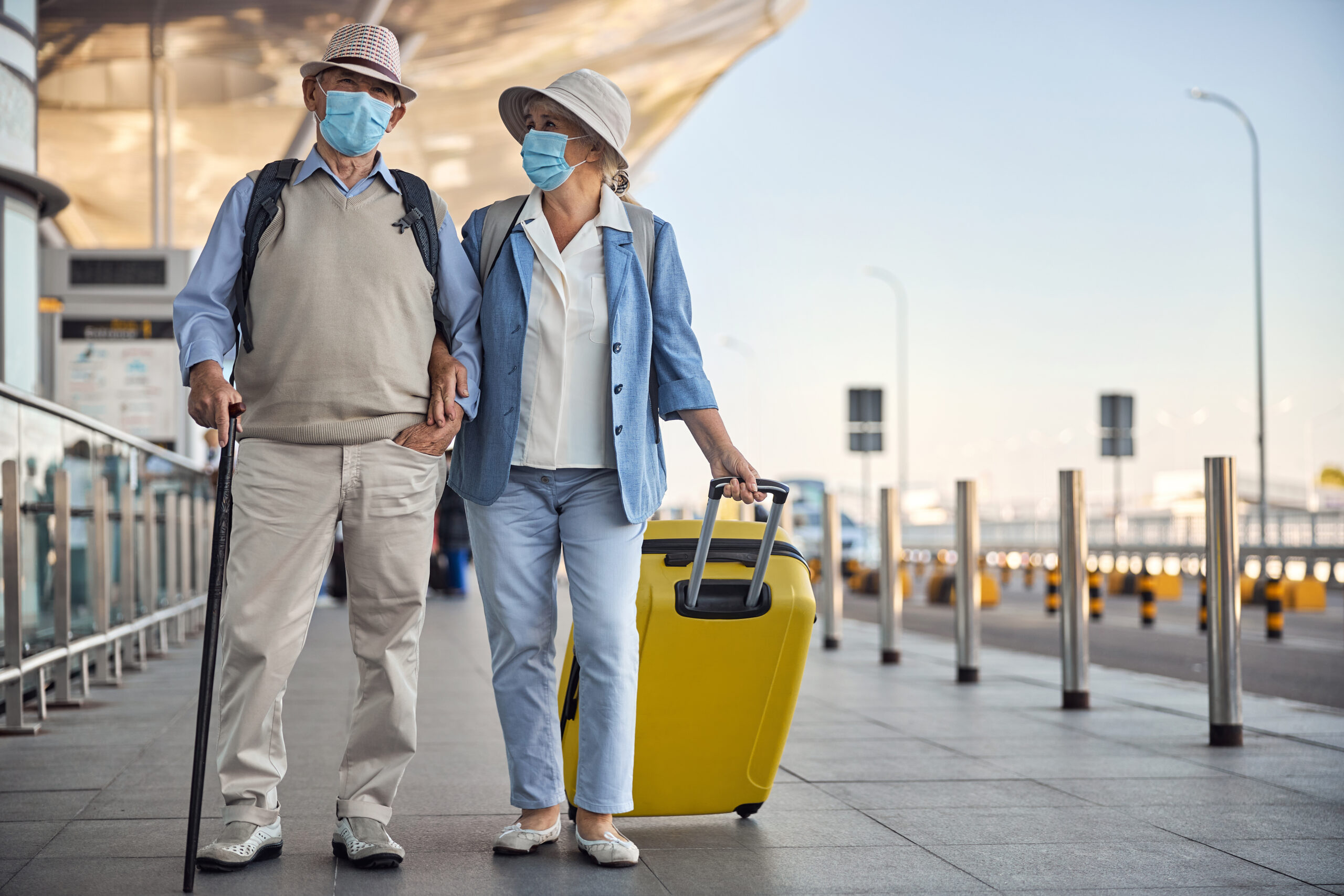 senior travellers at the airport