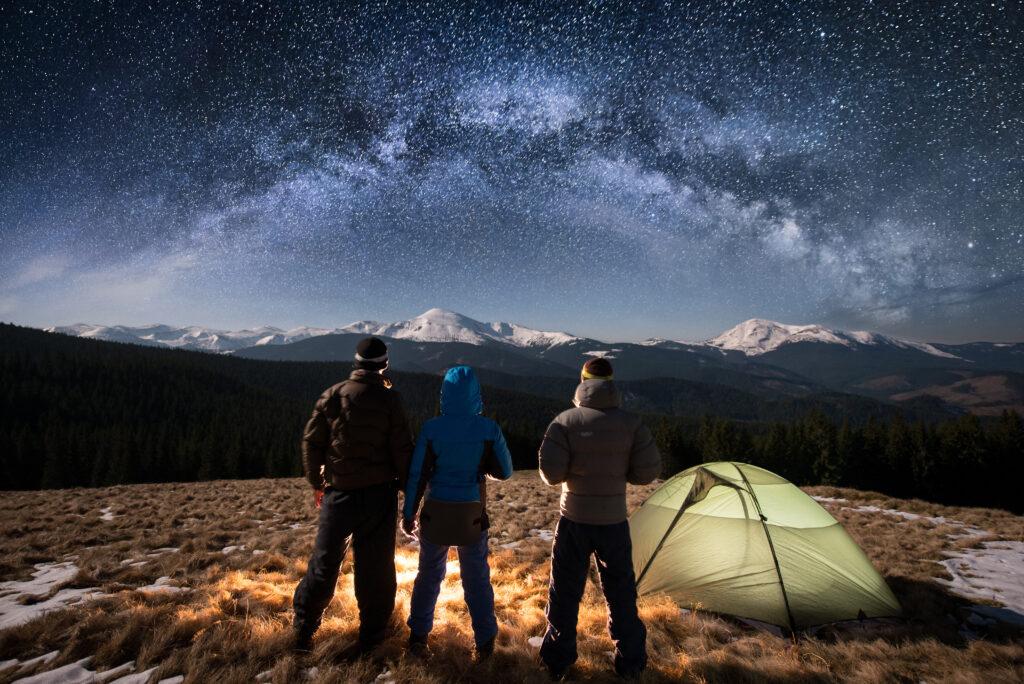 Hikers under night sky