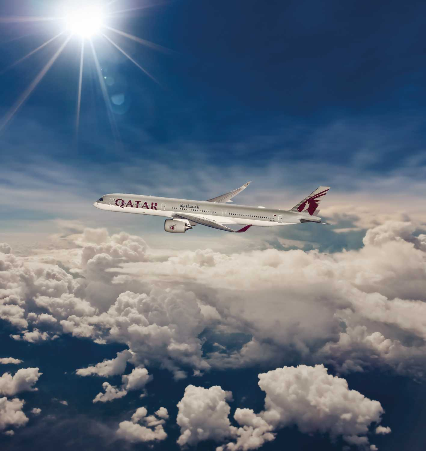 Qatar Airway plane flying above clouds