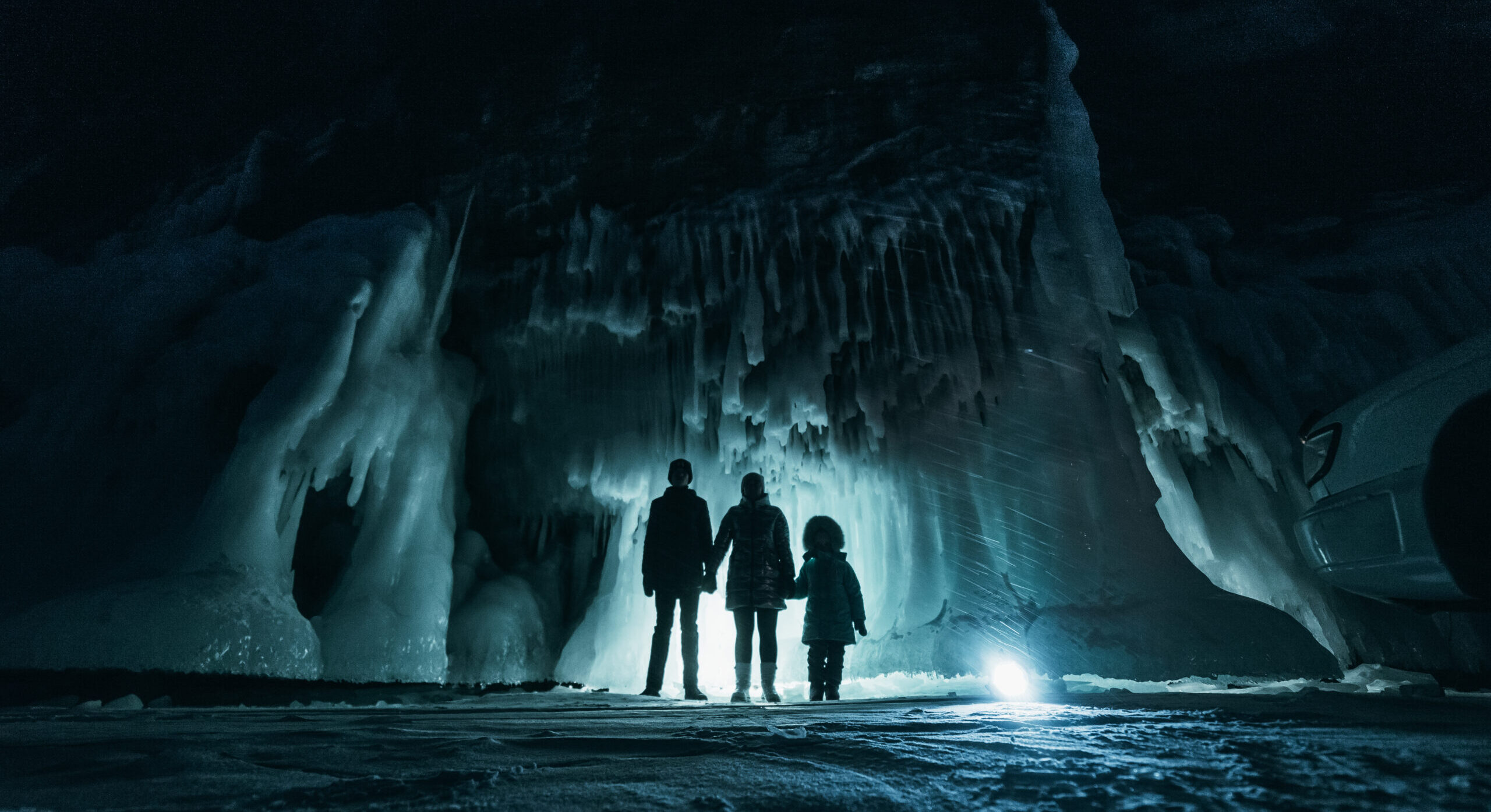 Family in ice cave
