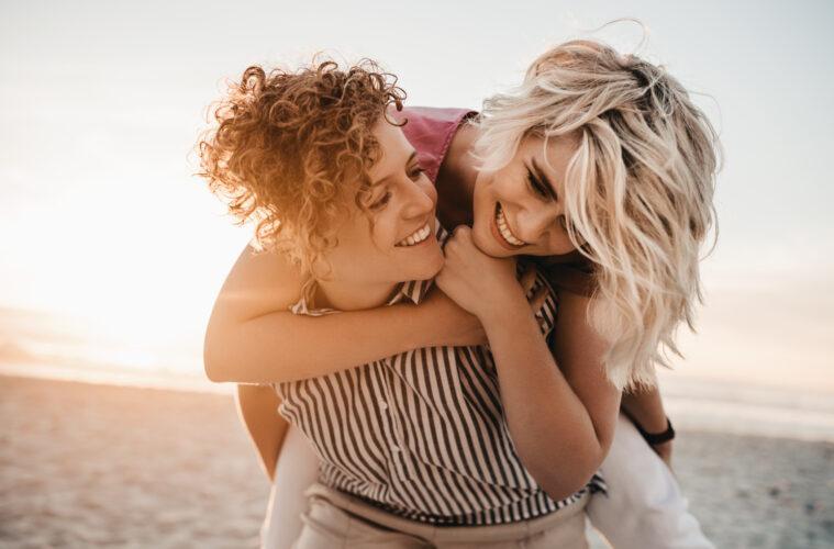 Female couple on beach