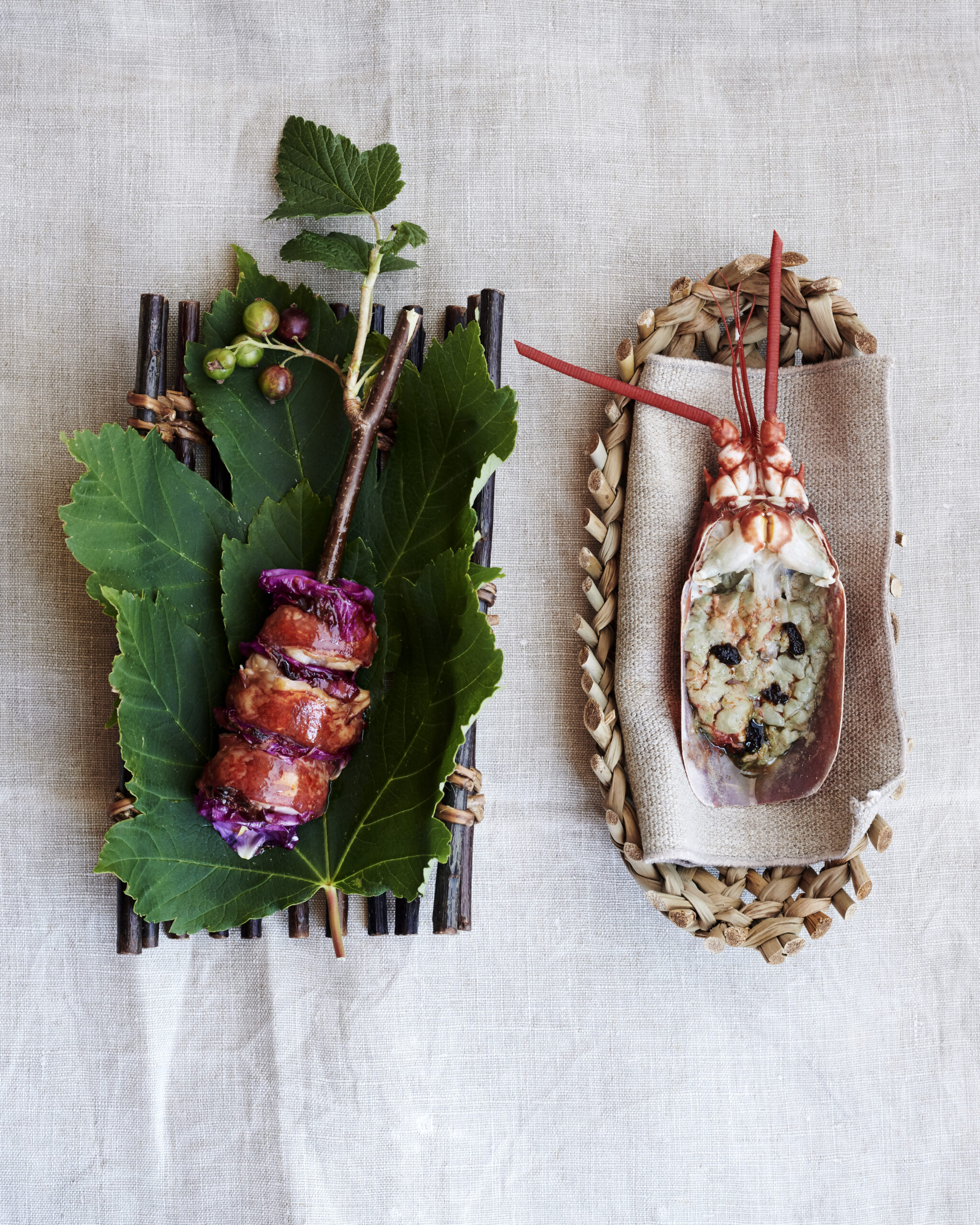 Noma - A skewer of grilled Danish black lobster with roses